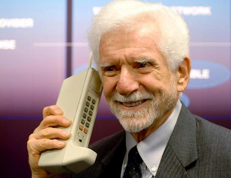 Martin Cooper with the first cell phone